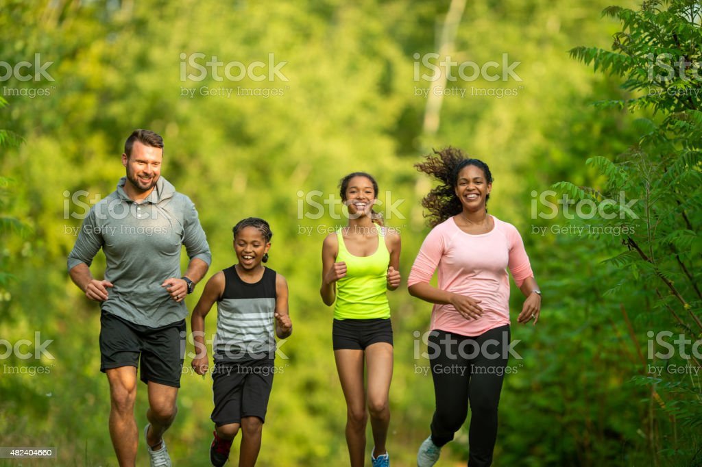 Family Jogging at the Park stock photo