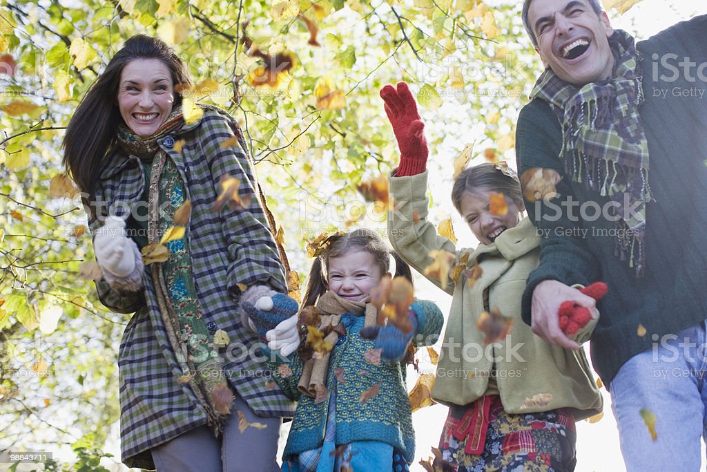 Family laughing and holding hands outdoors royalty-free stock photo