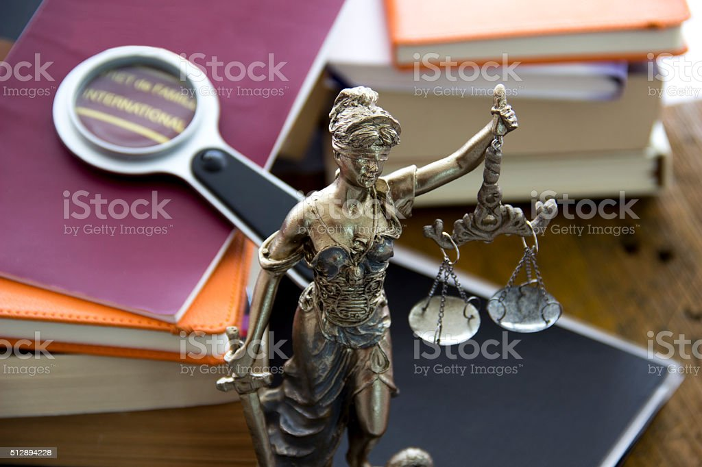 Family law. Justice statue with sword and scale stock photo