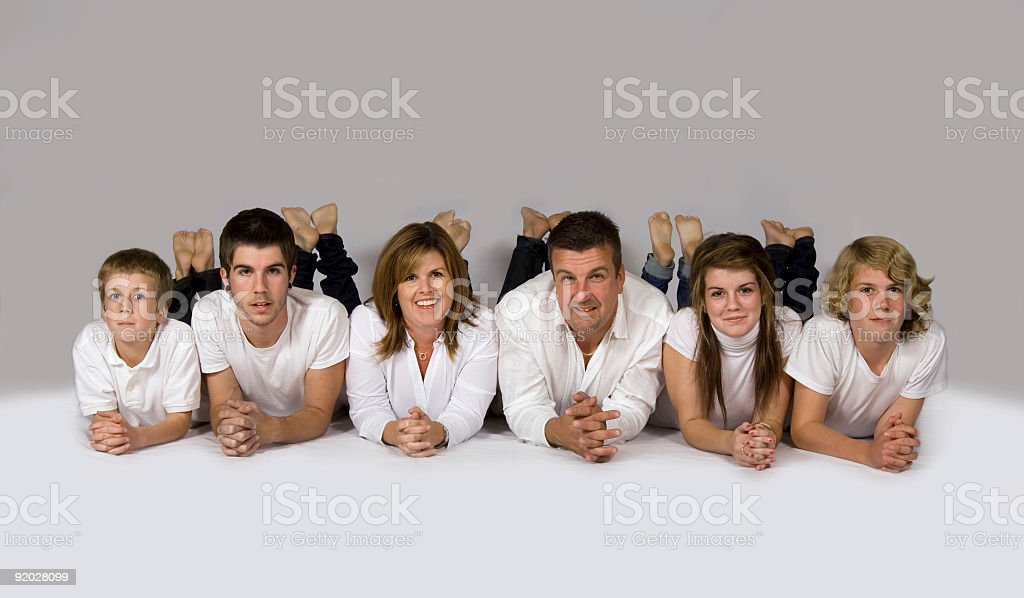 Family laying on floor together stock photo
