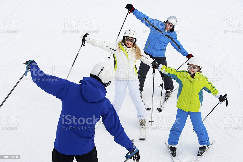 Family Learning to Ski with Instructor stock photo