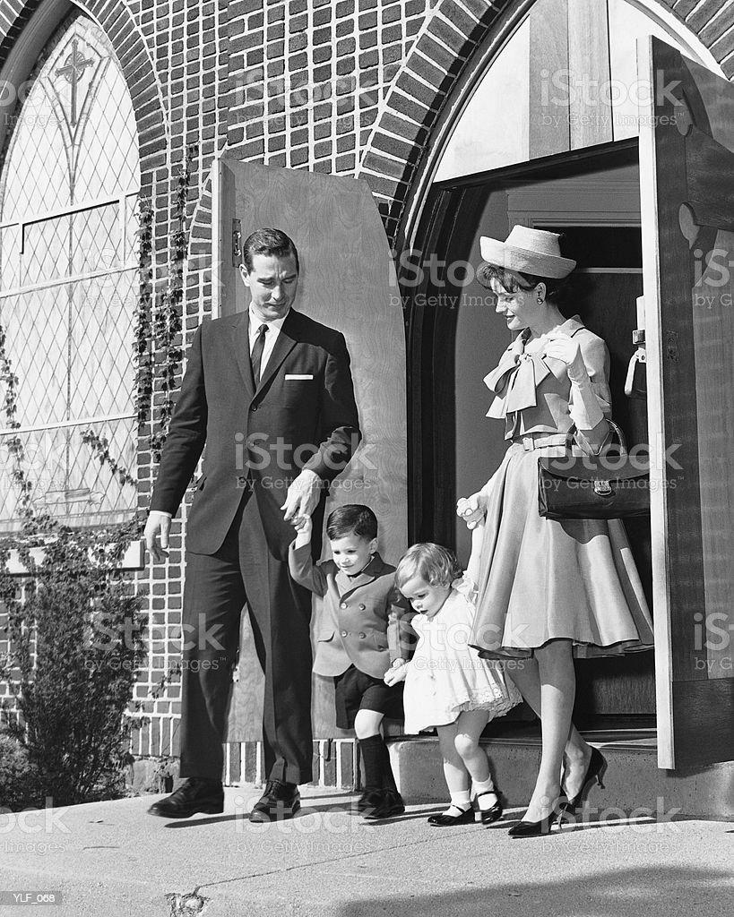 Family leaving church stock photo
