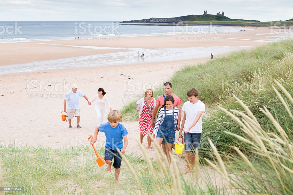 Family leaving the beach stock photo