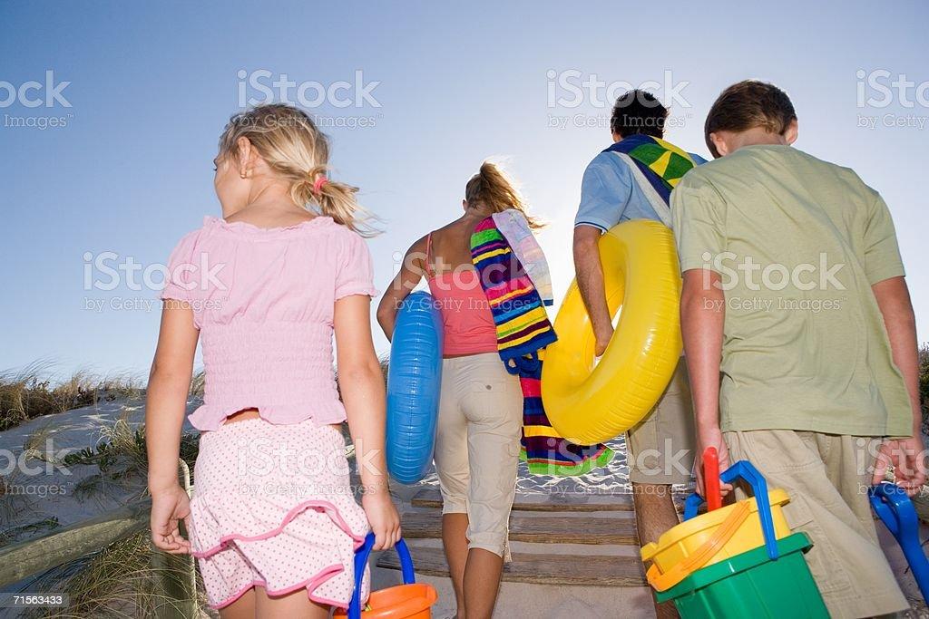 Family leaving the beach royalty-free stock photo