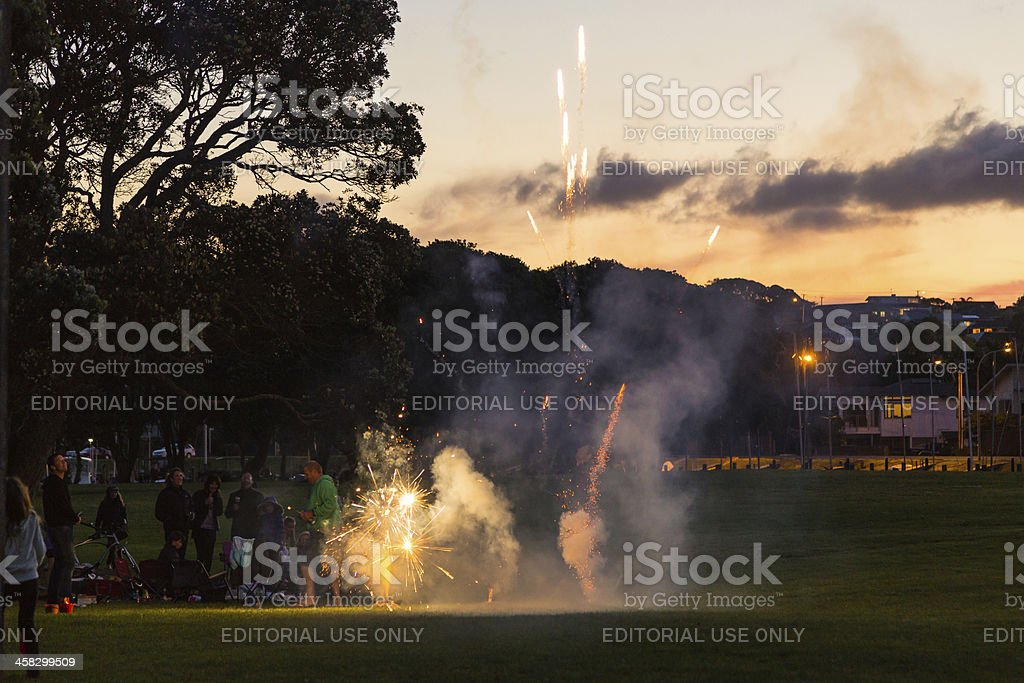 Family letting off fireworks stock photo