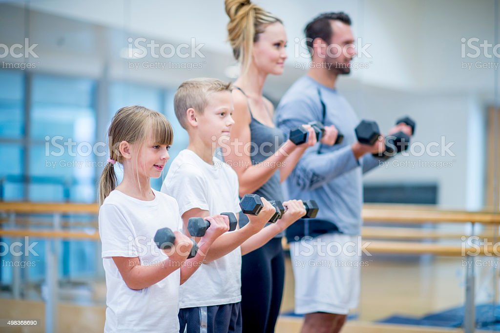 Family Lifting Weights Together stock photo