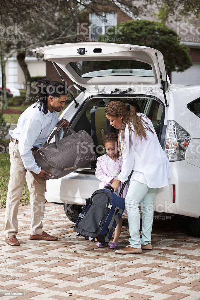 Family loading luggage into car stock photo