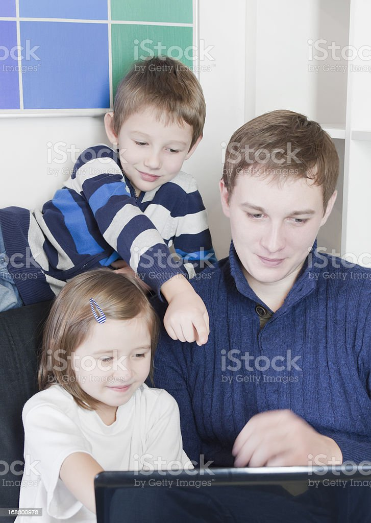 Family look at laptop royalty-free stock photo