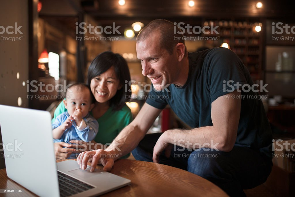 Family looking at a computer together stock photo