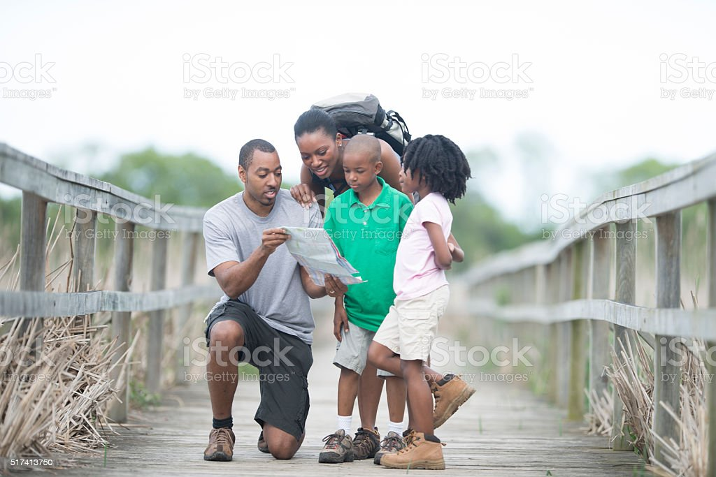 Family Looking at a Map Together stock photo