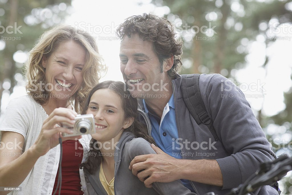 Family looking at camera in woods royalty-free stock photo