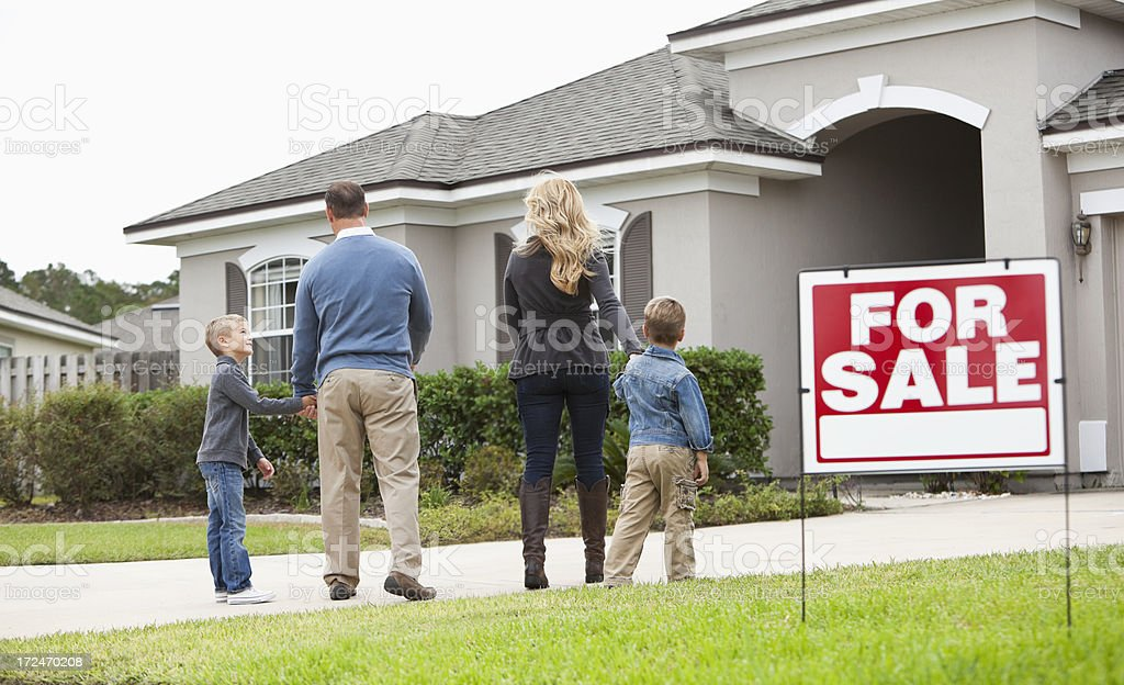 Family looking at house for sale stock photo