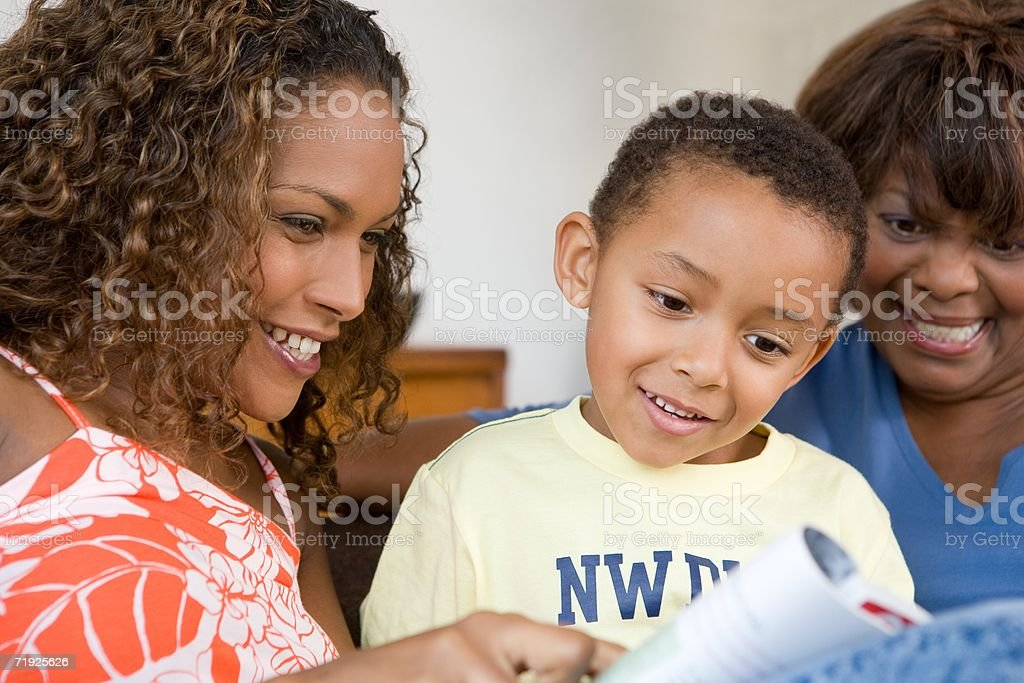 Family looking at magazine royalty-free stock photo