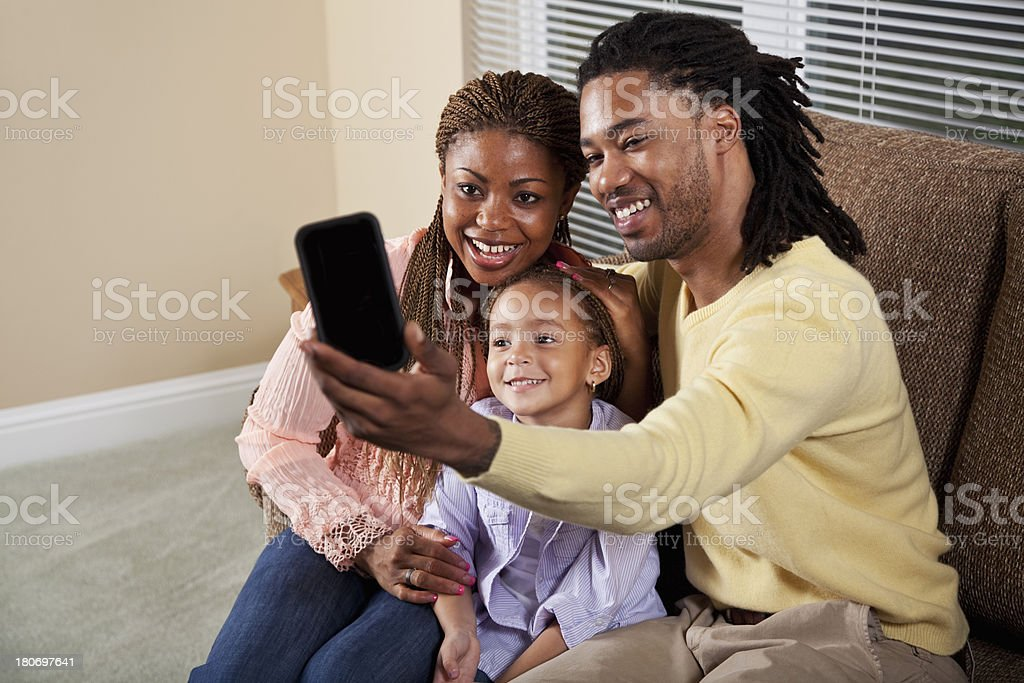 Family looking at phone stock photo