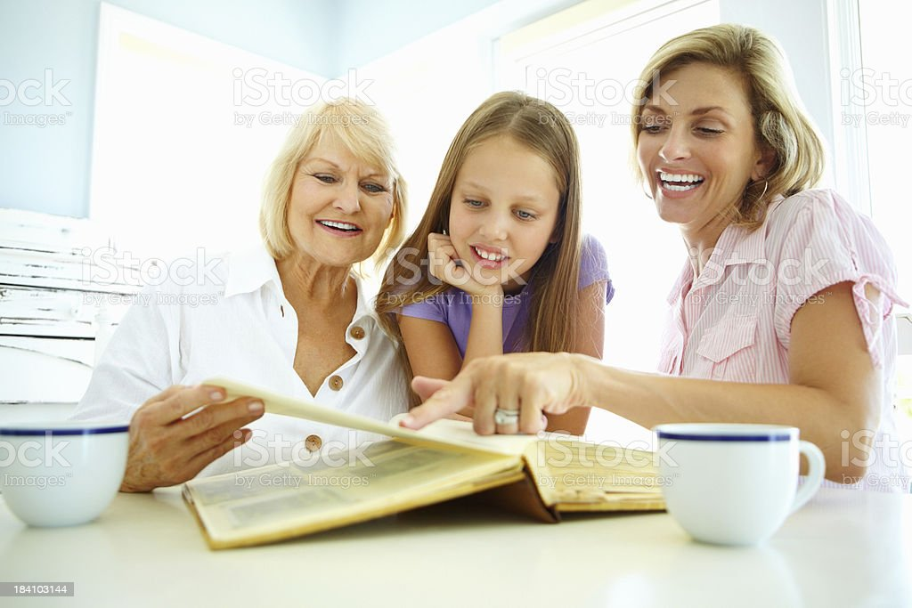 Family looking at photo album royalty-free stock photo