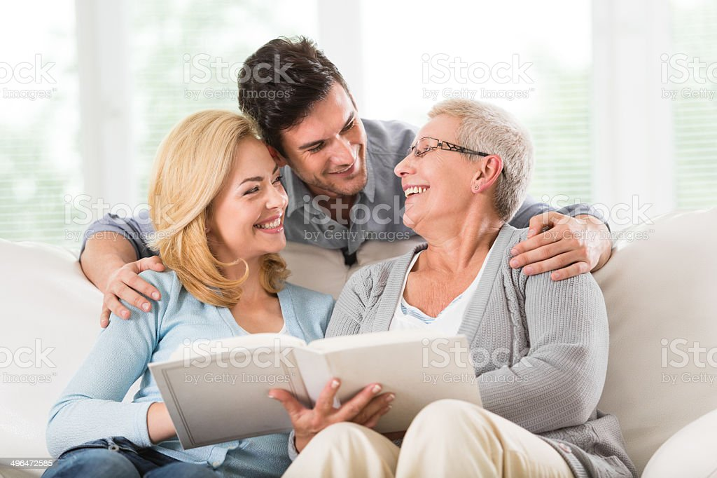 Family looking at photos in album stock photo