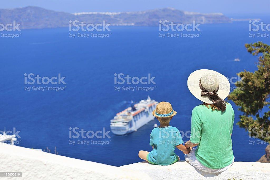 family looking at Santorini, Greece stock photo