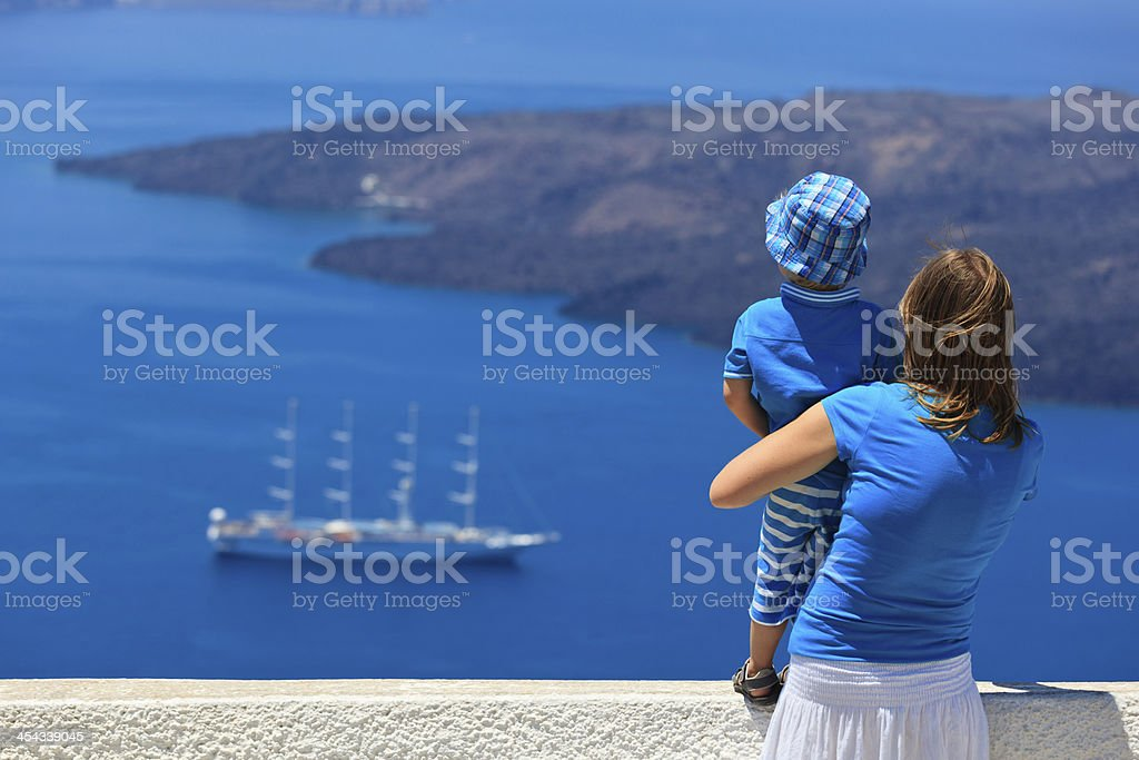 family looking at Santorini, Greece royalty-free stock photo
