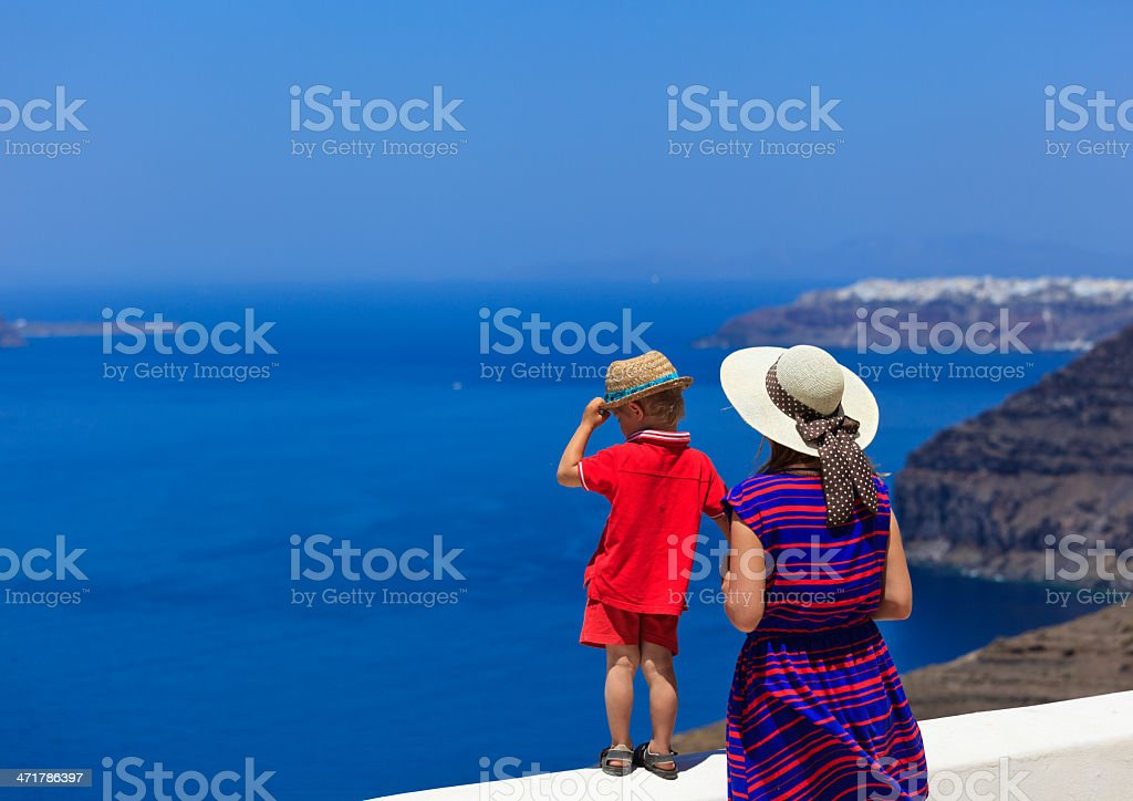 family looking at Santorini, Greece royalty-free stock photo
