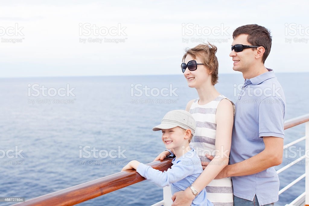 Family looking at the sea view during a cruise stock photo