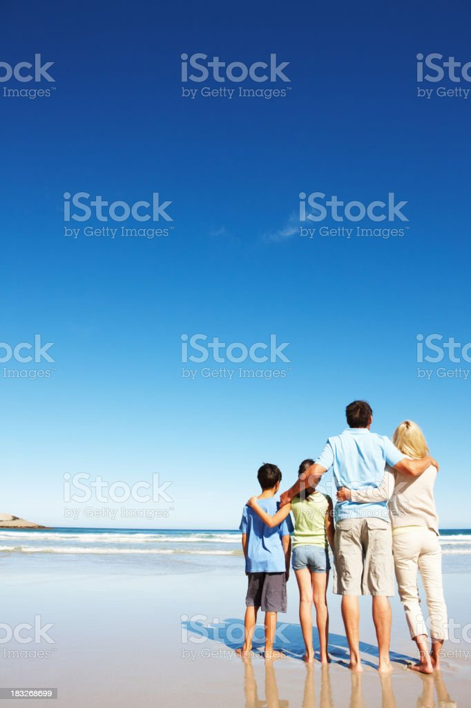 Family looking out into the ocean royalty-free stock photo