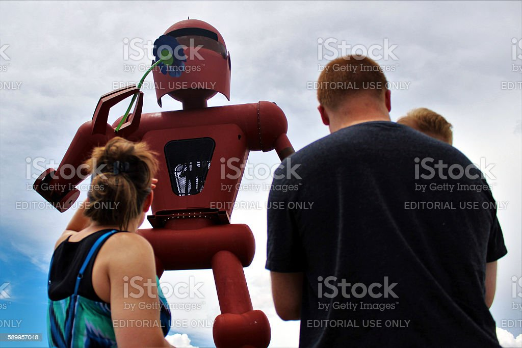 Family Looking Up At Giant Robot (Meow Wolf) stock photo