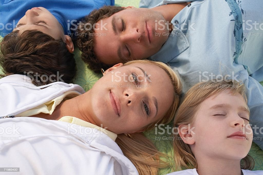 Family lying on a blanket royalty-free stock photo