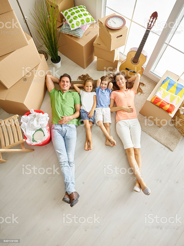 Family lying on floor and smiling stock photo