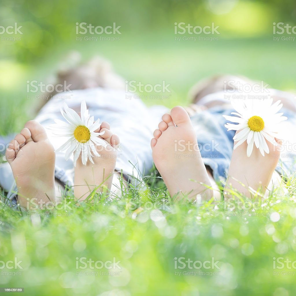 Family lying on grass royalty-free stock photo
