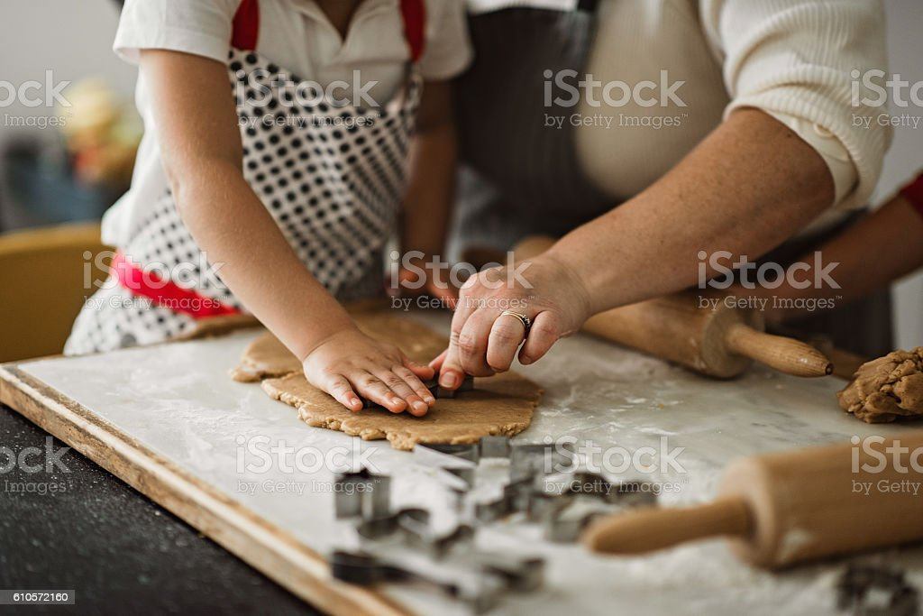 Family making christmas  ginger cookies stock photo