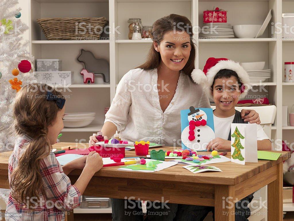 Family Making Chrsitmas Cards royalty-free stock photo