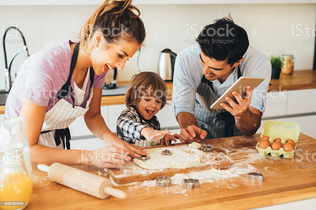 Family making cookies in the kitchen stock photo