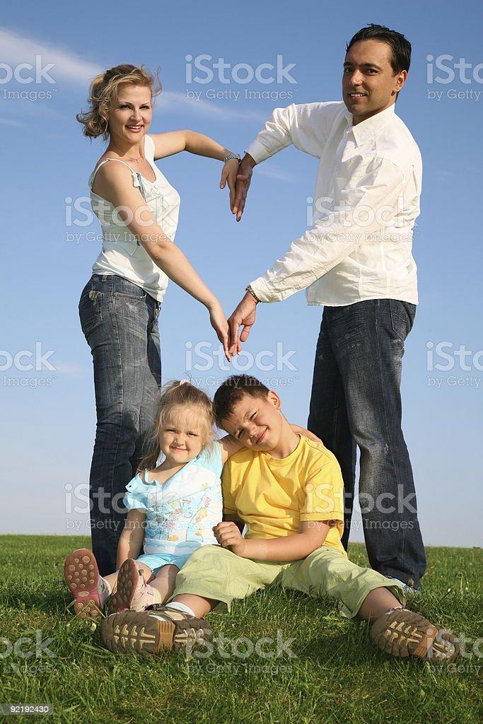 family making heart. grass sky royalty-free stock photo