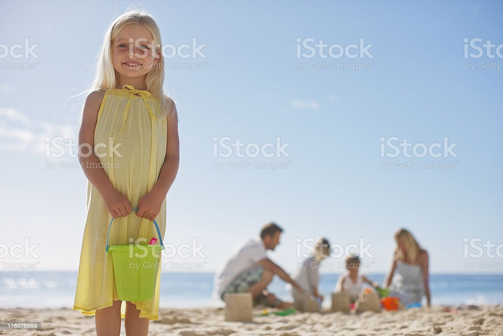 Family making sand castles on beach royalty-free stock photo