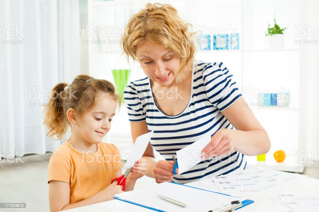 Family Making Shopping list and coupons. stock photo