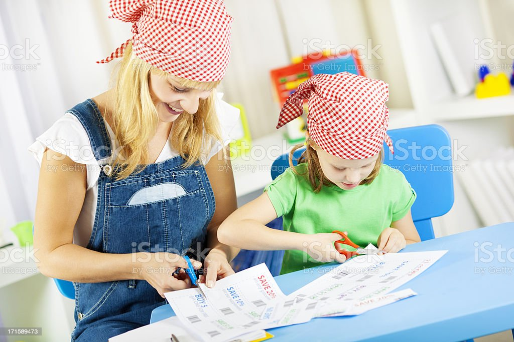 Family Making Shopping list and cut coupons. stock photo