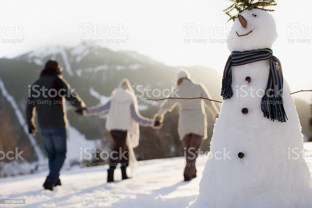 Family making snowman stock photo