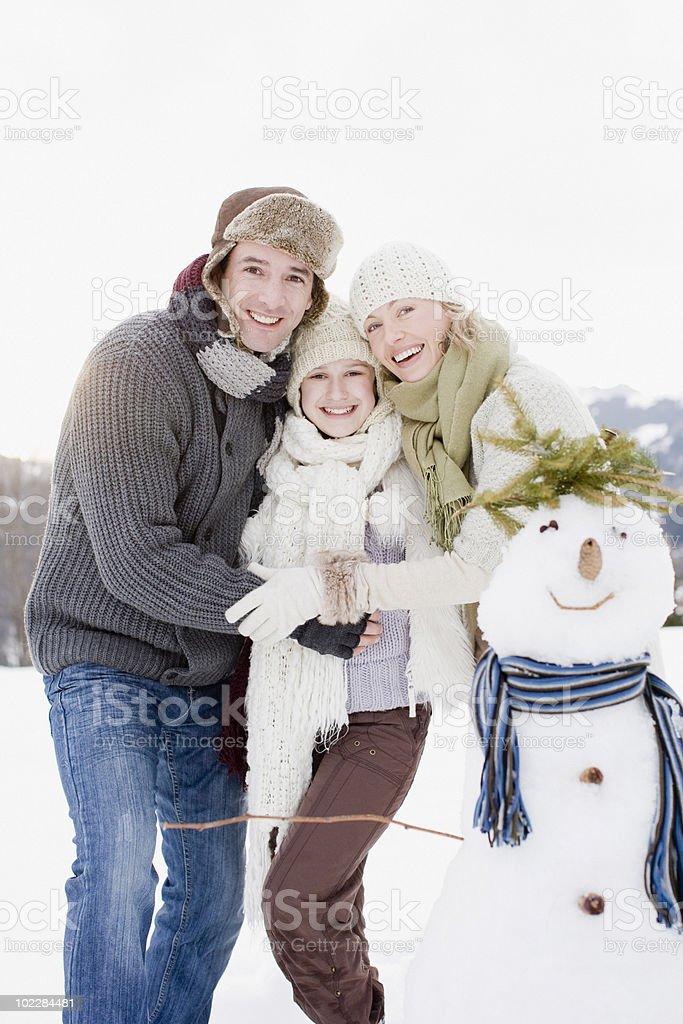 Family making snowman royalty-free stock photo