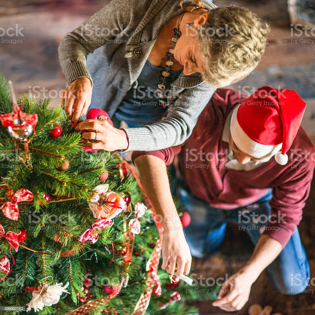 family making the christmas tree stock photo