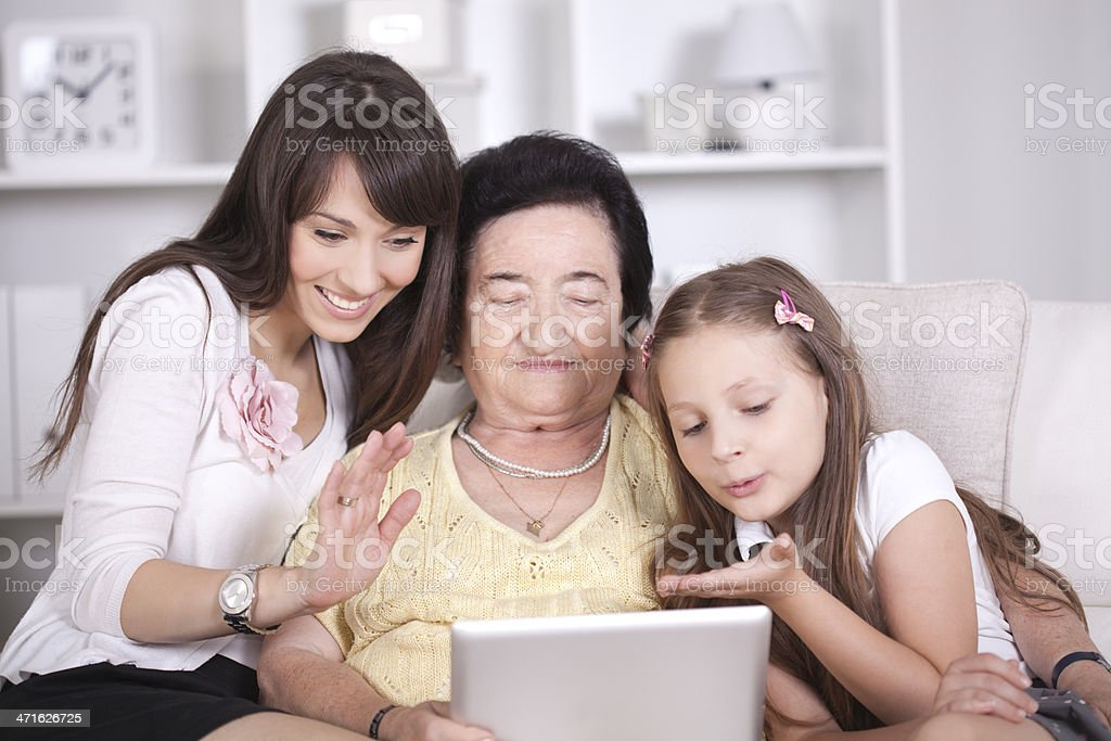 Family making video call. stock photo