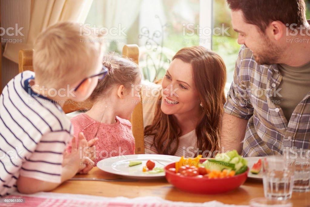 family mealtime fun stock photo