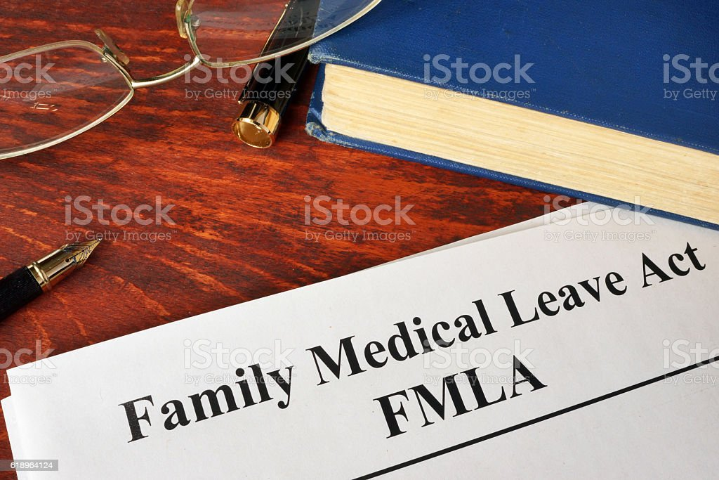 FMLA Family Medical Leave Act and a book. stock photo
