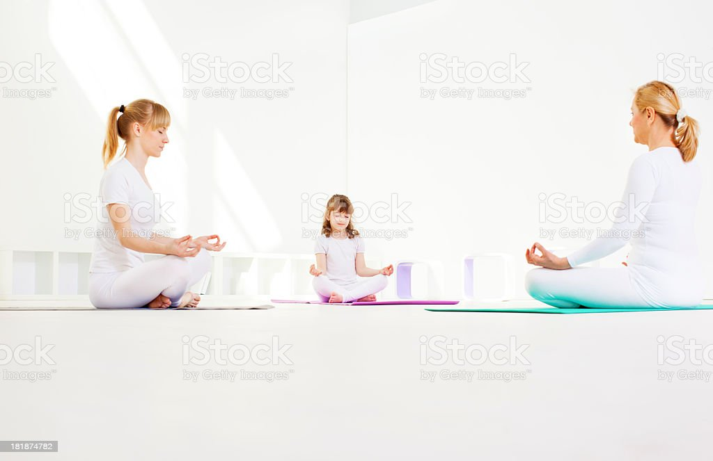Family Meditating. royalty-free stock photo