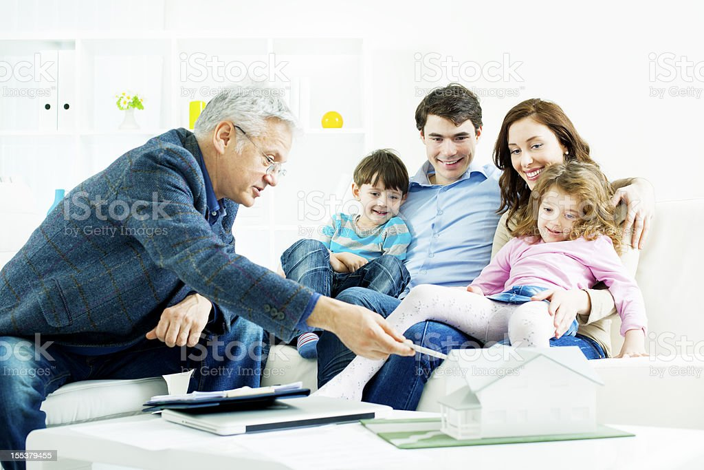 Family Meeting With Real Estate Agent. royalty-free stock photo