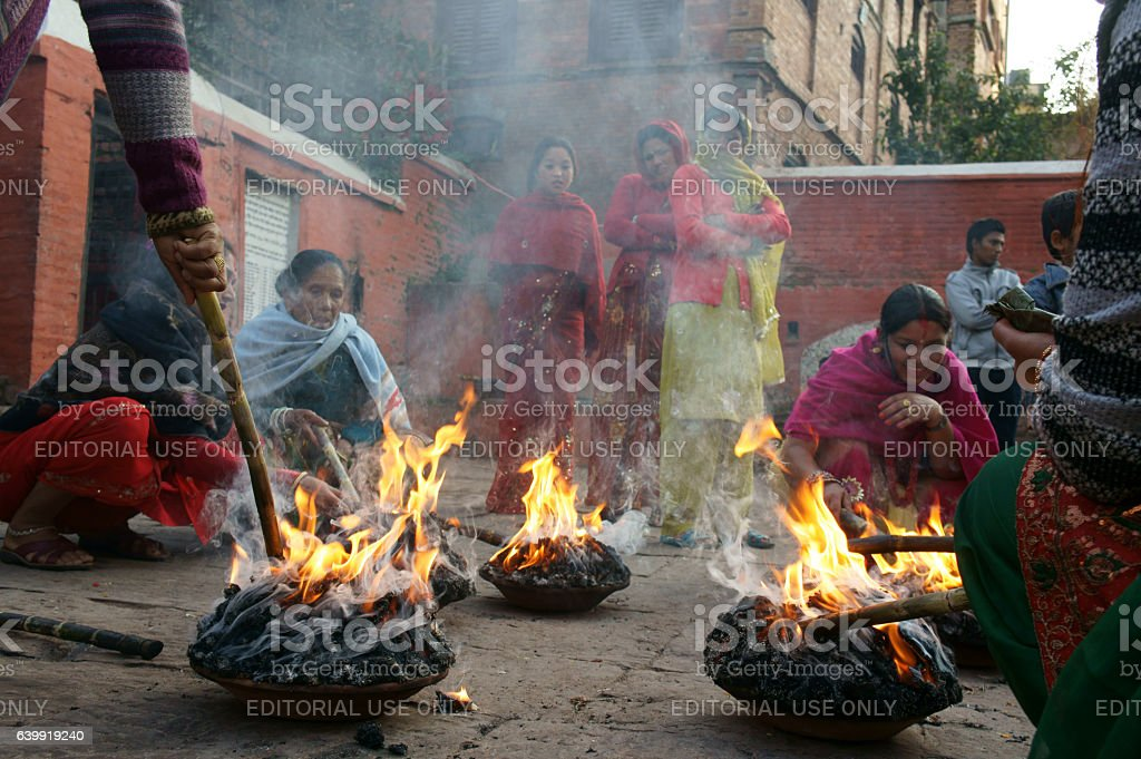 family member care abour ritual fire stock photo