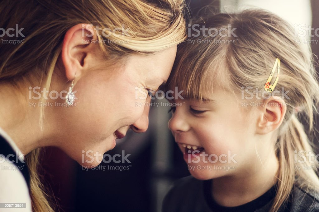 Family moment between mother and daughter stock photo