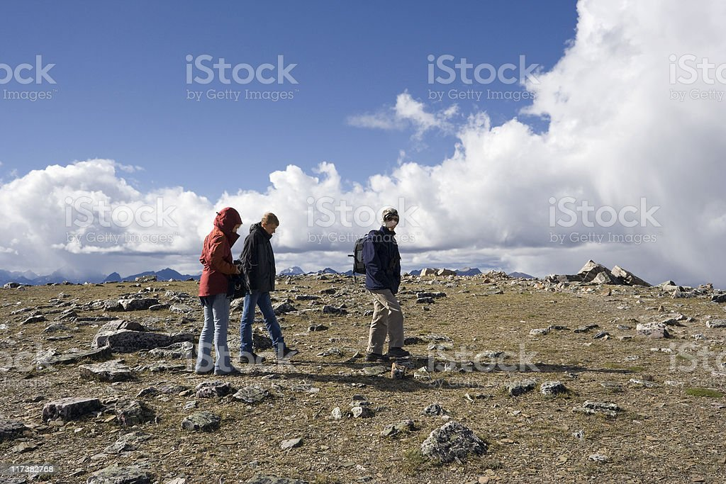 family mountain hiking on the summit royalty-free stock photo