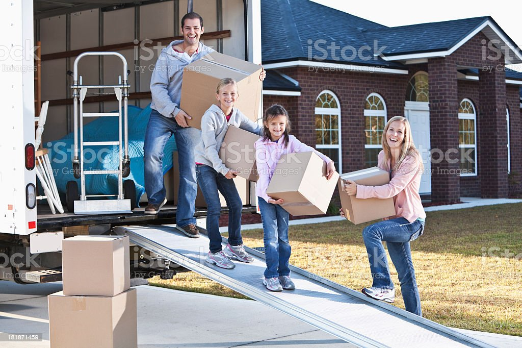 Family moving house, unloading truck stock photo