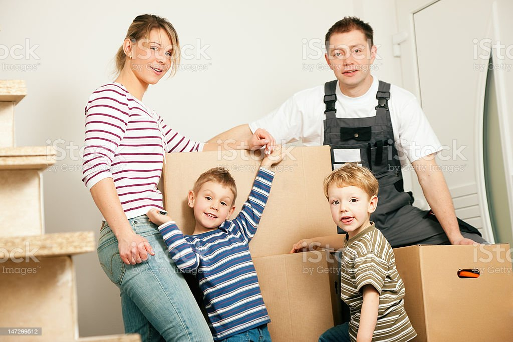 Family moving in their new house royalty-free stock photo
