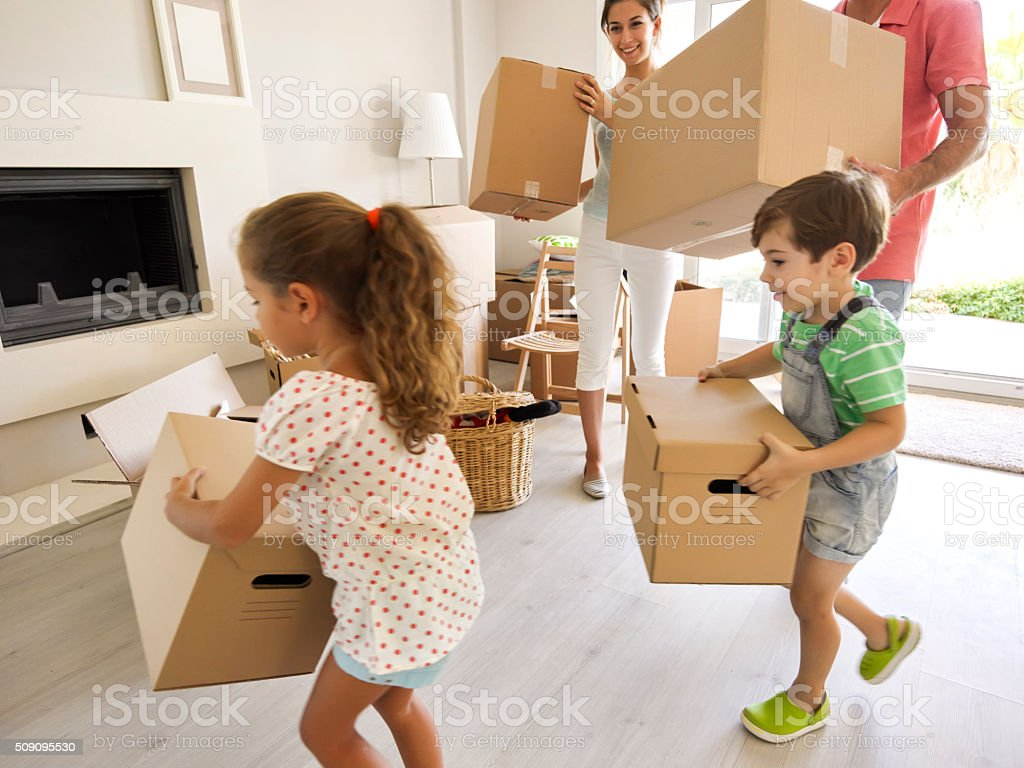 Family moving in to new home stock photo